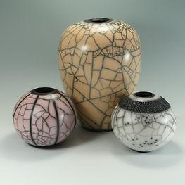 Trio of naked raku vessels