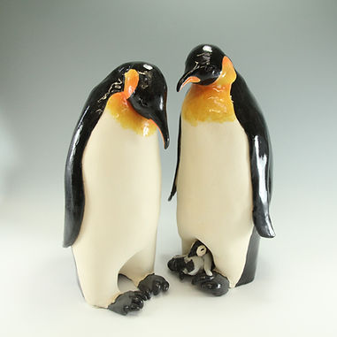A pair of glazed stoneware penguins