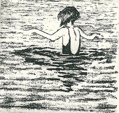 A young girl bathing in the sea