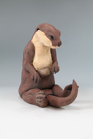 Sitting otter - slip decorated stoneware
