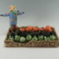 The scarecrow in the vegetable patch - glazed stoneware