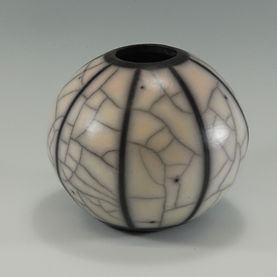 Naked raku sphere with coloured slip