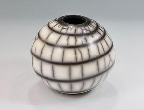 Naked raku sphere with swirl decoration