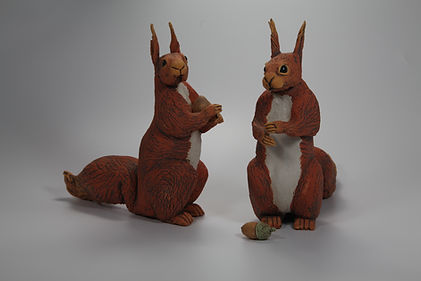 Two red squirrels - coloured slip decorated stoneware