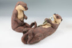Two otters with coloured slip decoration