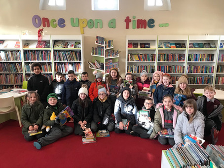 Ms Kerrigan's 3rd Class visit the library