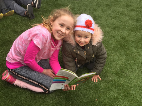 Ms Ivers and Ms Kerrigans had fun Buddy Reading on World Book Day