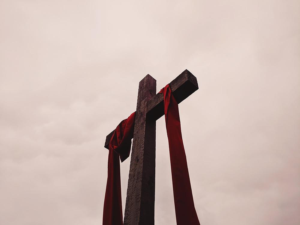 Wooden cross draped for Lent