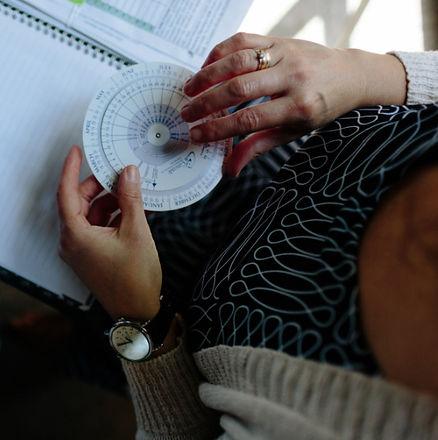 midwife holding pregnancy wheel