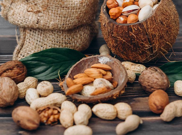 almonds, peanuts and walnuts in coconuts