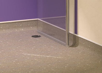 Space savinge hinged glass screens for wet rooms with vinyl flooring