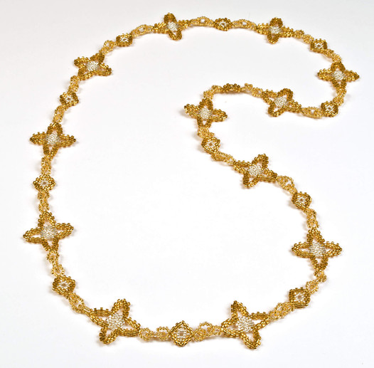 Quatrafoil Gold Silver.jpg