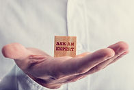 Picture of someone holding a small card in their hand saying Ask the Expert