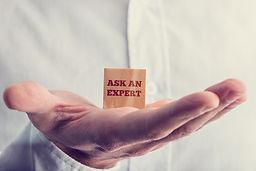 hand holding an Ask an Expert sign