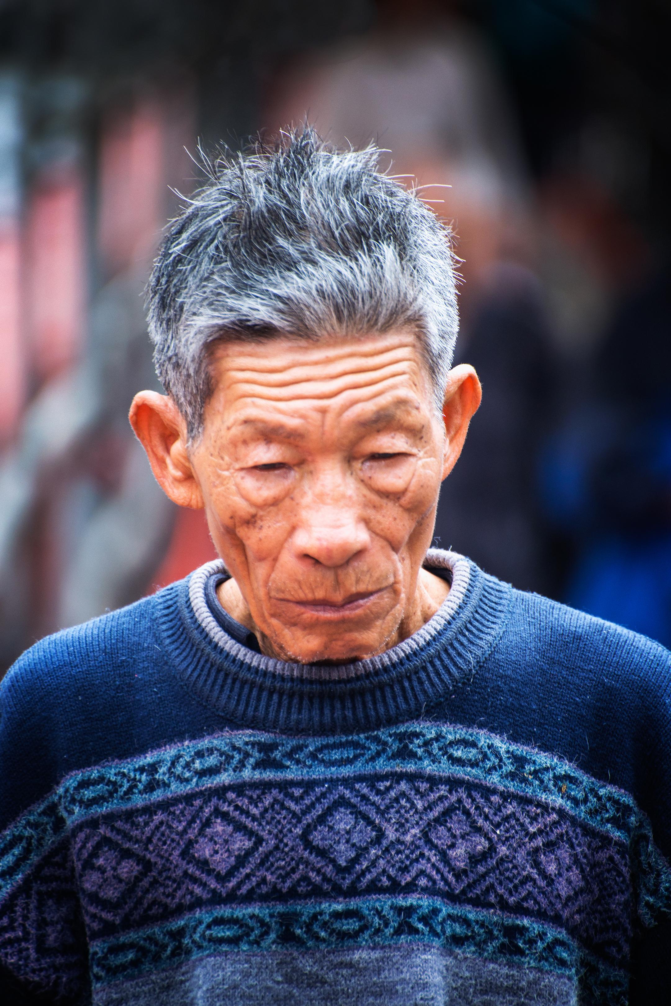 Man in Blue Sweater Chinatown San Franci
