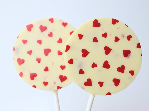 White chocolate lollipop with yoghurt and raspberry pieces