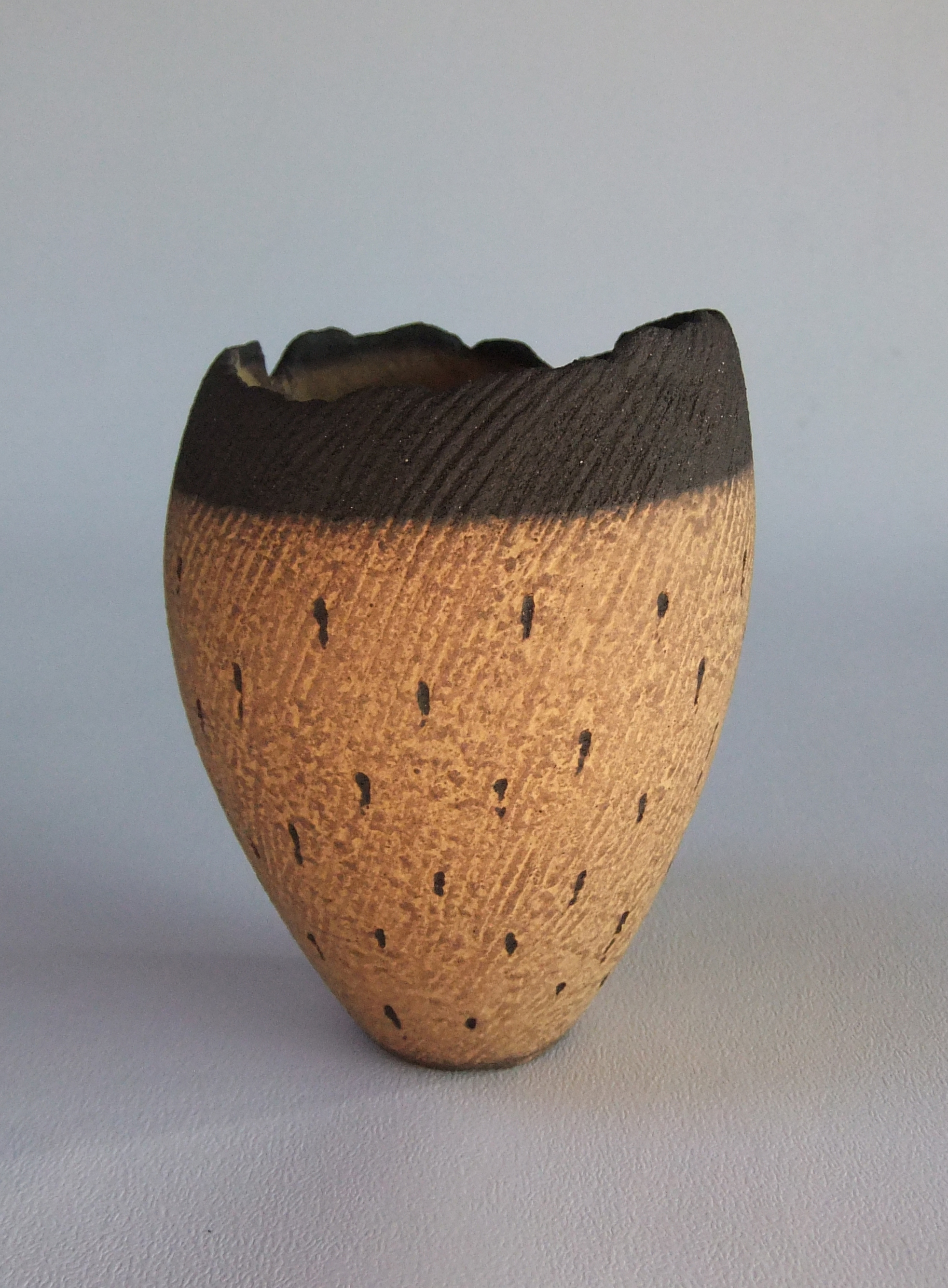 Pinched pot, coloured slip