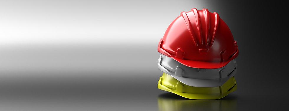 ENVATO-safety-hard-hats-stack-on-grey-ba