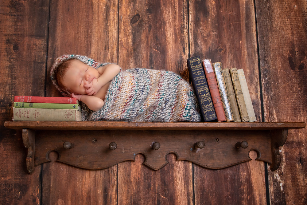 newborn session, baby on a bookshelf, baby with books, books