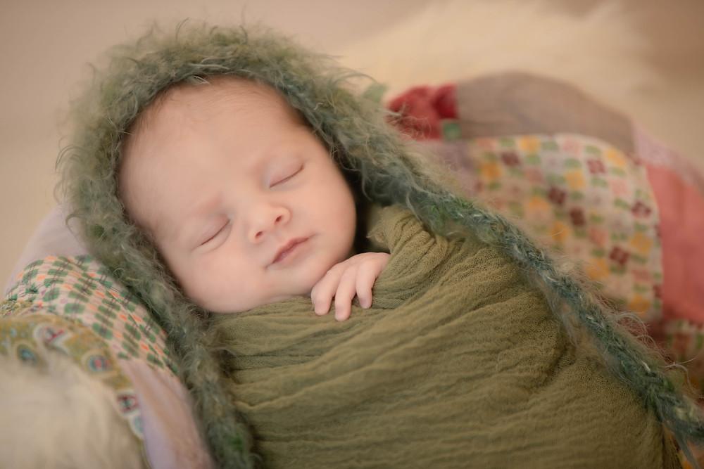 fuzzy hat, quilt, sleeping baby, newborn wrap