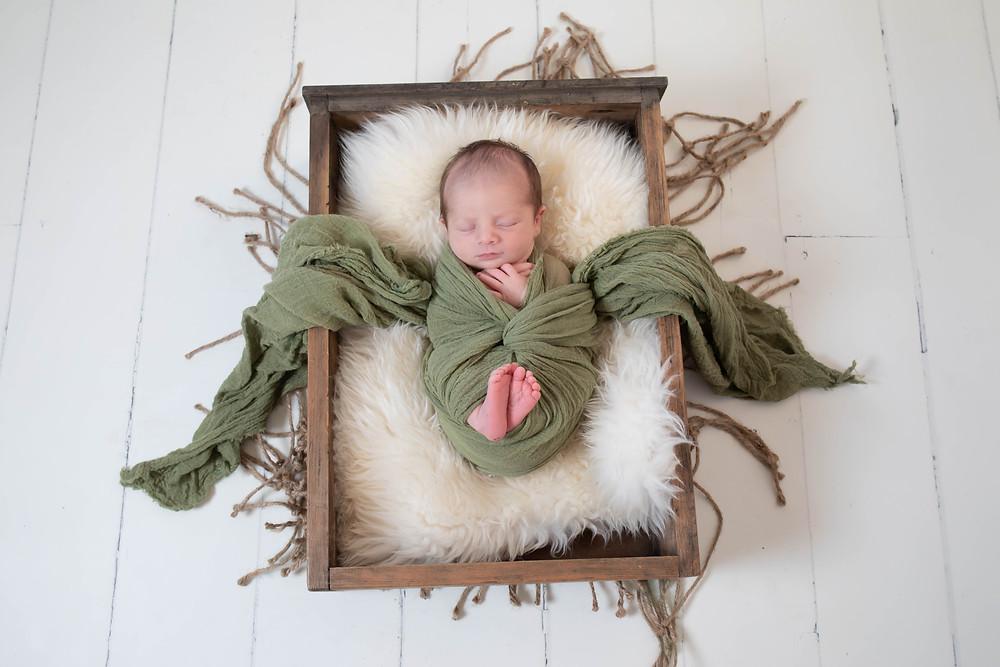 newborn baby, newborn session, newborn wrap, green wrap, baby in a box,