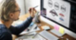 Logo designer working on a computer