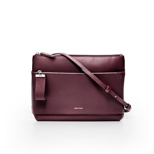 L'Espiègle - Un sac en bandoulière et une pochette de soirée en cuir aubergine