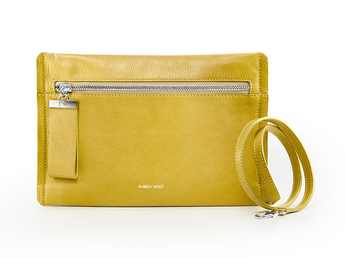 L'Indécise - the Undecided. A small clutch with adjustable shoulder strap. Corn colour, light grained leather