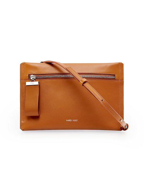 L'Indécise - the Undecided. A small clutch with adjustable shoulder strap. Tobacco smooth leather