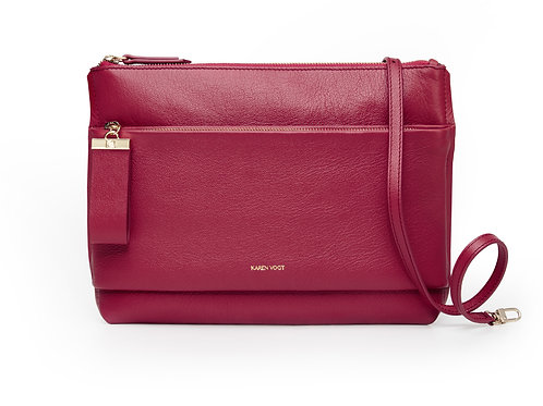 L'Espiègle - the mischievous. A cross-body bag and an evening pouch in grained raspberry leather