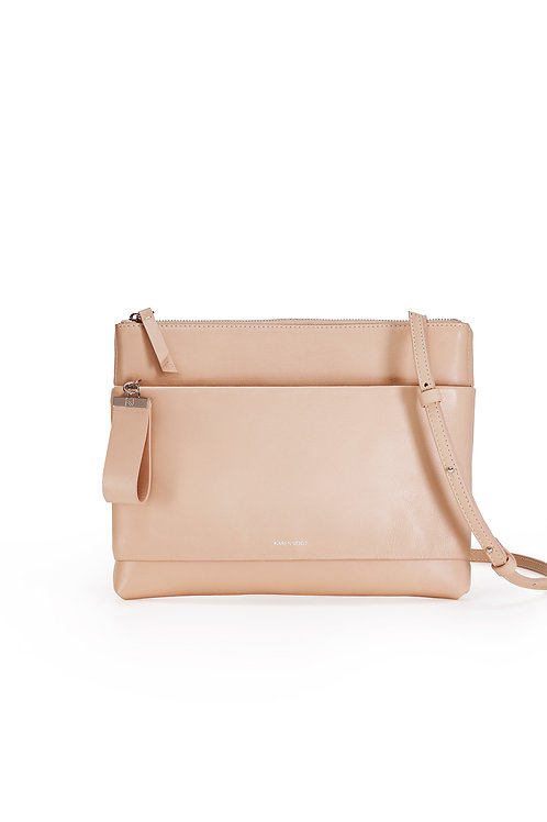 L'Espiègle, the mischievous. A cross body bag and an evening pouch in nude smooth leather