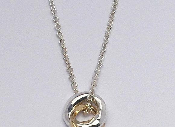 Small mixed metal circle pendant