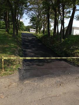 narrow driveway roped off