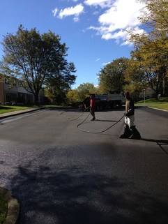 Crew sealcoating parking lot