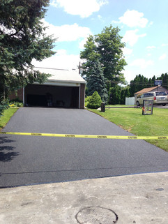 Driveway sealed off after sealcoating