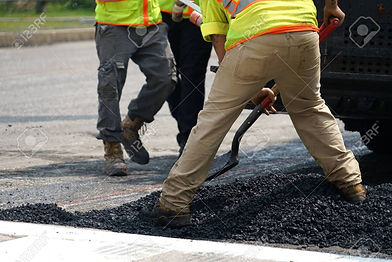 147868545-worker-paving-the-road-with-as