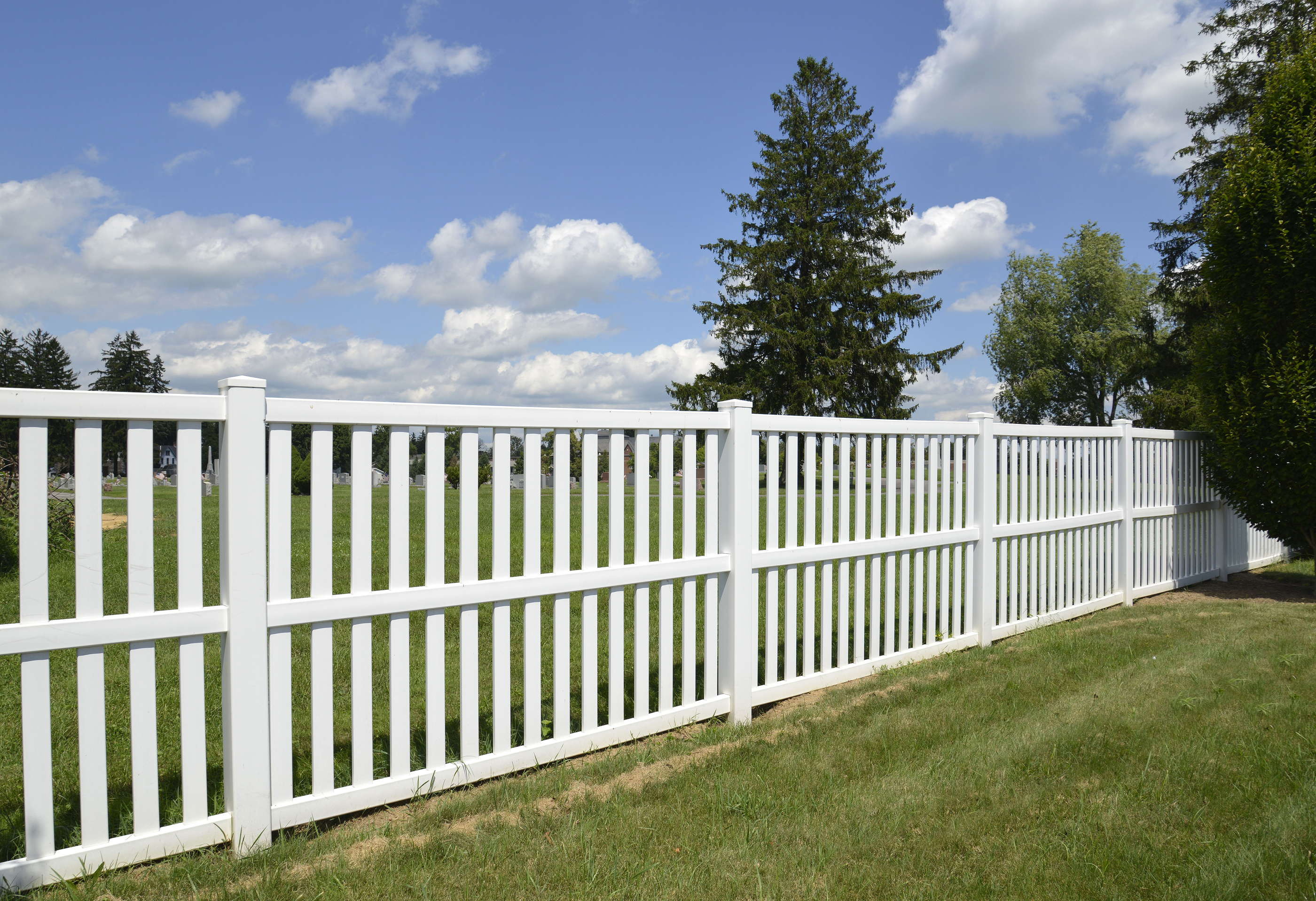 White Vinyl Fence By Green Lawn.jpg