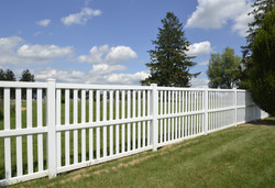 White Vinyl Fence By Green Lawn.jpg
