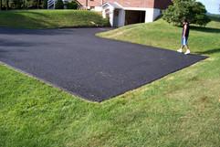 Homeowner inspecting paving