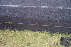 stakes pushed into driveway