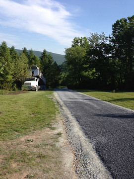 Crew paving residential driveway in wood