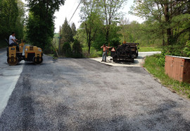 Crew performing tar chip paving