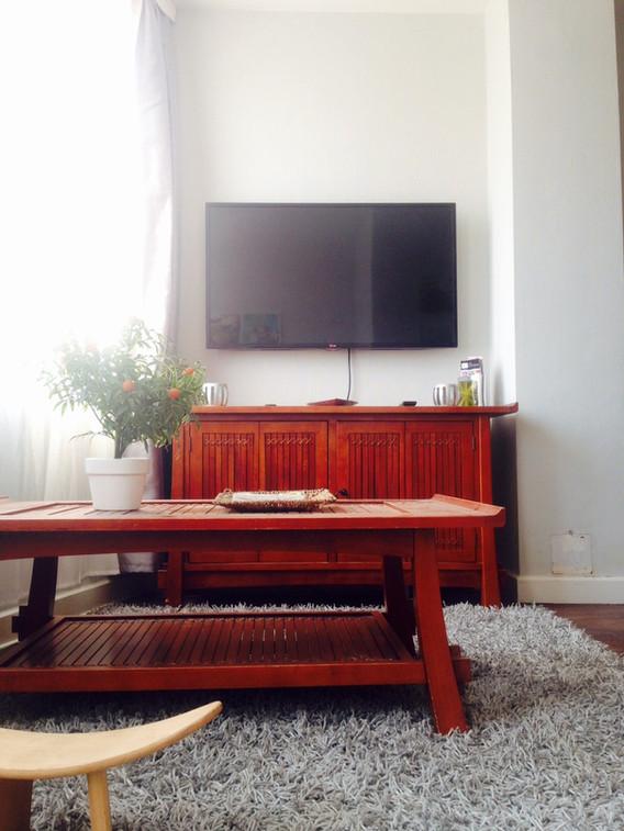 Meublé Les Bambous - Coin TV du salon