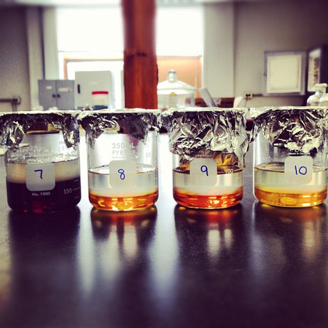 Extracted organic molecules from rapid pyrolysis experiments. Darker liquids were from hotter and/or longer runs, while lighter liquids were from shorter and/or lower temperature runs.