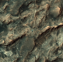 View of Curiosity from orbit as it crosses the Stimson formation (image credit: NASA/JPL/UA/Emily Lakdawalla).