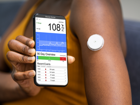 How does a continuous glucose monitor (CGM) work?