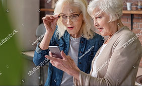 stock-photo-cheerful-senior-ladies-using
