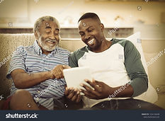 stock-photo-smiling-father-and-son-using