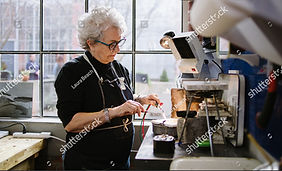 stock-photo-art-jeweler-working-in-studi