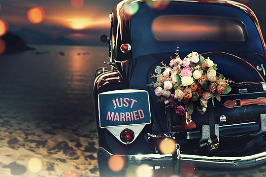 Wedding bouquet on vintage wedding car.j